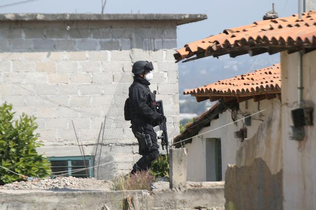 'They finished them off': Mexican town rocked by ambush that killed 13 cops